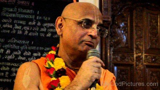 Bhakti Charu Swami Holding Mic