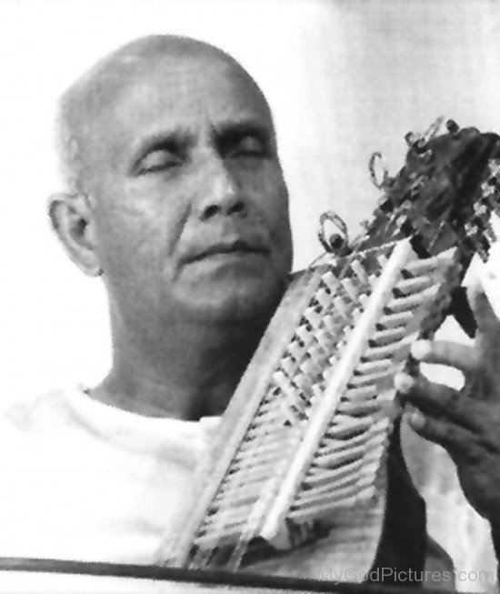 Sri Chinmoy Playing Sitar