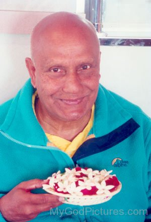 Sri Chinmoy With Flowers