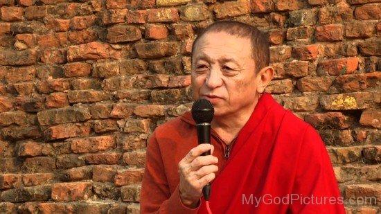 Chokyi Nyima Rinpoche Holding Mic