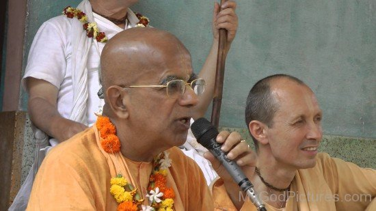 Gopala Krishna Goswami Holding Mic