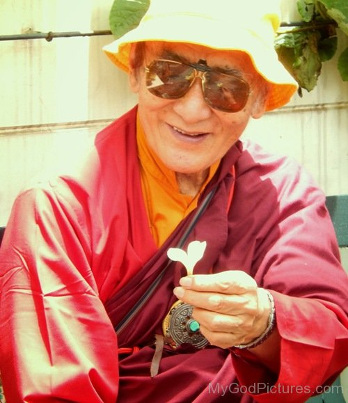 Karma Thinley Rinpoche Holding Flower