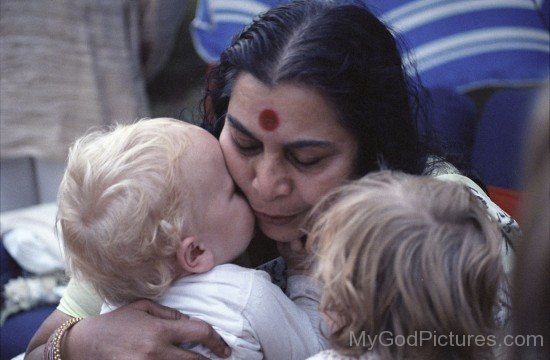 Nirmala Srivastava With Little Child