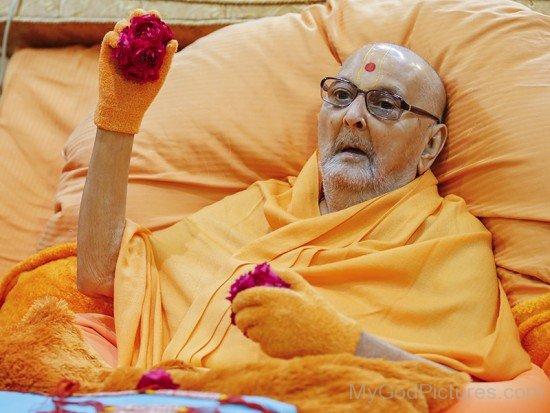 Pramukh Swami Maharaj Holding Roses