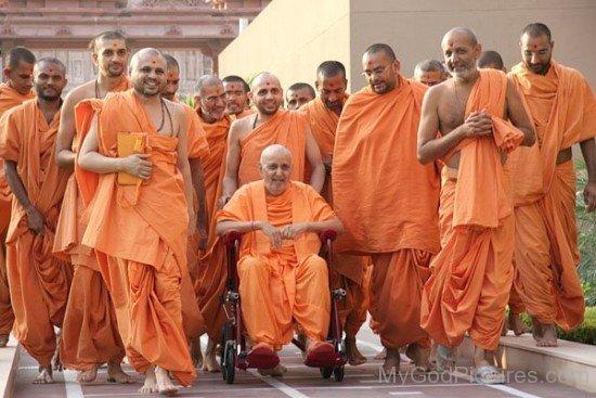 Pramukh Swami Maharaj On Wheel Chair With Devotees