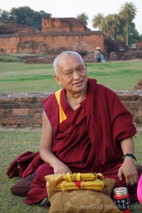 Thubten Zopa Rinpoche Sitting On Ground