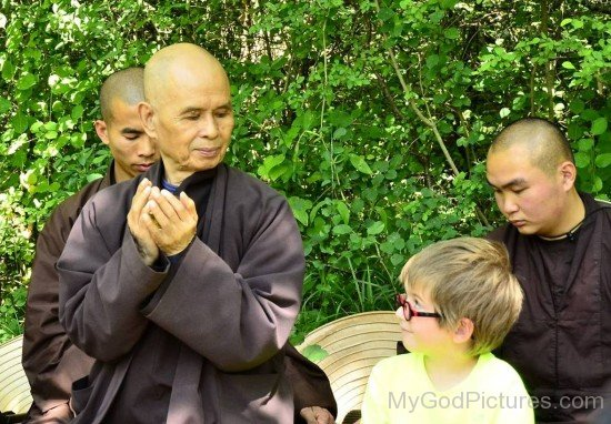 Thich Nhat Hanh Looking At Little Boy