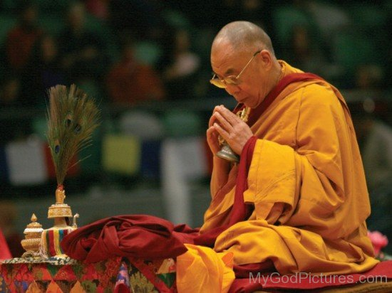 Tenzin Gyatso Praying